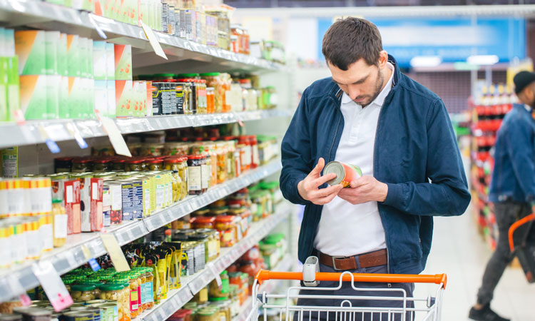 Man browsing food label in supermarket