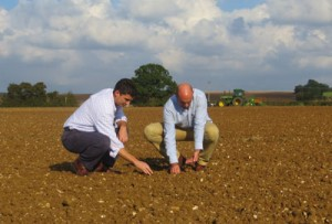 Tom Rivett and Tim Walpole of H Banham grain merchants checking the sowing of the 50th anniversary crop of Maris Otter barley in October 2014